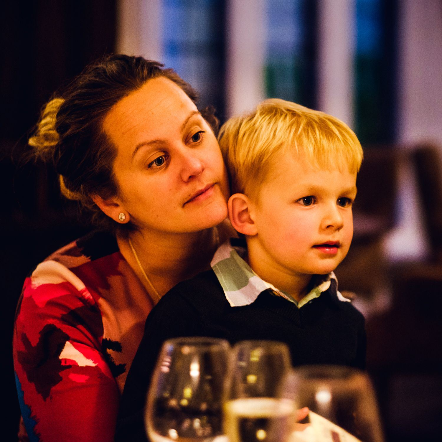 Candid portrait of mother and son at event