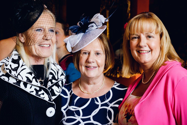 portrait of women in hats at wedding