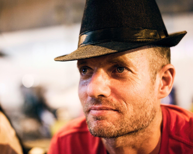 street portrait of man with pork pie hat