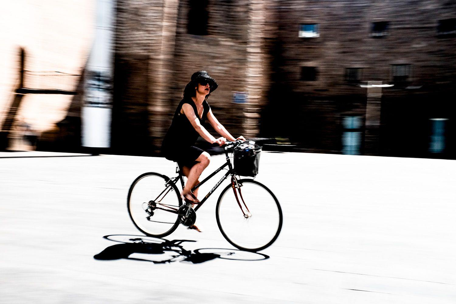 Street photo of woman on a bicycle