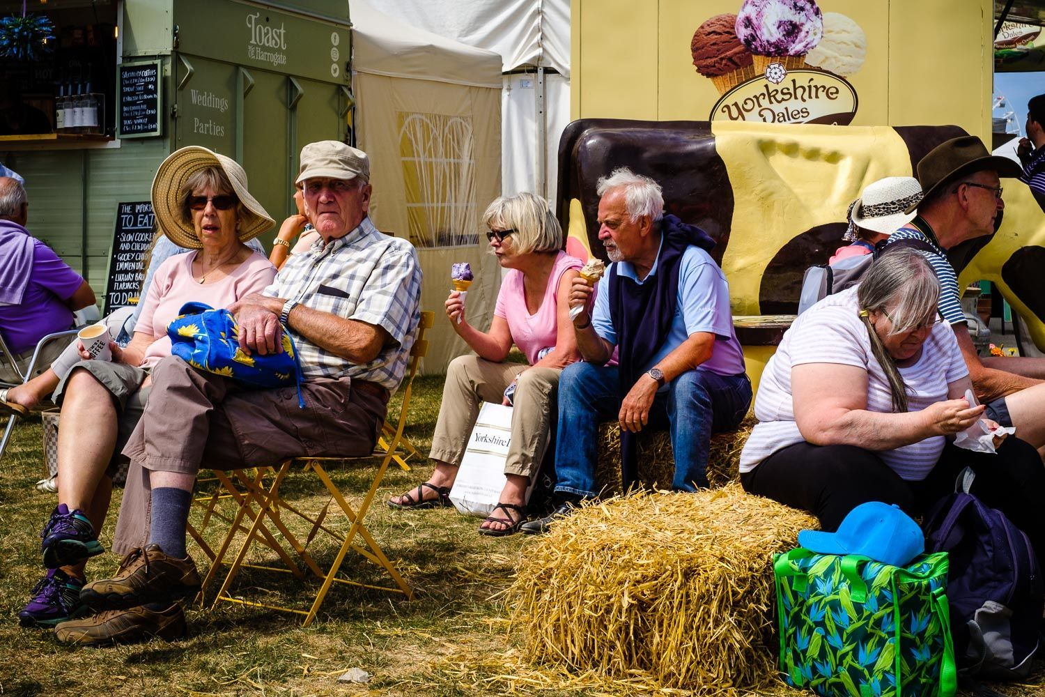 street photo of mature icecream eaters at country show